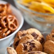 Cookies and pretzels in bowls, shallow DOF - 