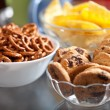 Cookies and pretzels in bowls, shallow DOF — Stock Photo #4977405