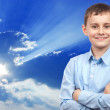 Schoolboy over sky background — Stock Photo #5051959
