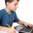 Schoolboy at the laptop — Stock Photo