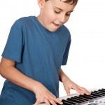 Boy playing piano — Stock Photo #5132270