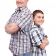 Royalty-Free Stock Photo: Father and son back to back