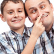 Father and son making funny faces — Stock Photo
