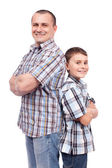 Father and son back to back — Stock Photo