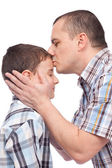 Father kissing his son on the forehead — Stock Photo