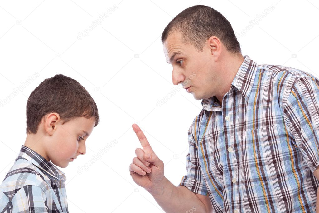 Father keeping a lesson to his son about behaving  Stock Photo #5132322
