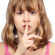 Cute girl making silence sign — Stock Photo