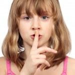 Cute girl making silence sign — Stock Photo