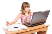 Schoolgirl doing homework at her laptop — Stock Photo