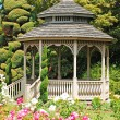 Stock Photo: Wooden gazebo in rose garden