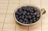 Blueberries in a tin cup — Stock Photo