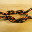 Square knot on wood background — Photo