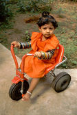 Baby, Bangles and Tricycle — Stock Photo
