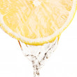 Splash of water on lemon - Stock Photo