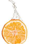 Orange is dropped into water splash — Stock Photo