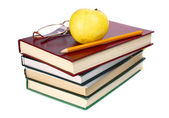 Books apple glasses and pencil — Stock Photo