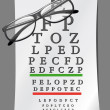 Eye charts and glasses - Stock Photo