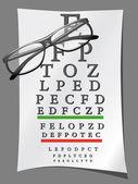 Eye charts and glasses — Stock Photo
