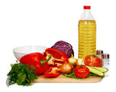 Sunflower seed oil and vegetables for preparation of salad — Stock Photo