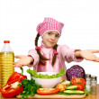 Royalty-Free Stock Photo: Girl preparing salad from vegetables