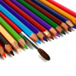 Crayons coloured pencils and brush for paints — Stock Photo