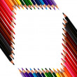 Frame made out of crayons coloured pencils — Stock Photo