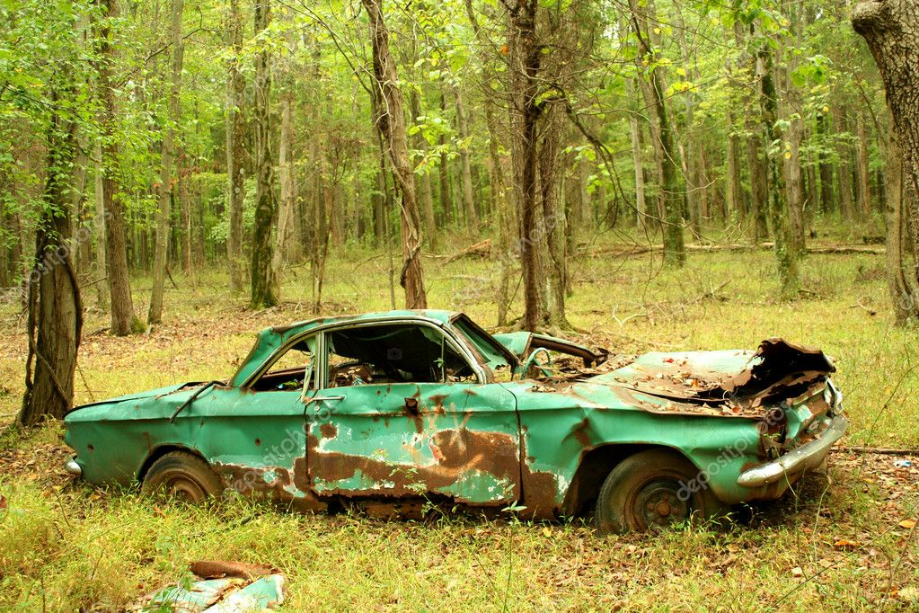 A Abandoned car in the woods  Stock Photo #3975218