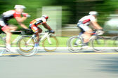 Blurred motion bicycle race — Stock Photo