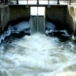 Water flowing through a canal lock - Stock Photo