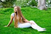 Girl on green grass — Foto Stock