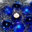 Blue Christmas baubles and a candle — Stock Photo