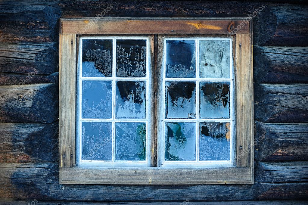 Window of a traditional Norwegian hut with frost patterns — Stock Photo #4745023