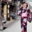 Japanese girl walking on street — Stock Photo #4090230