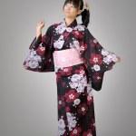 Happy japanese girl dancing — Stock Photo
