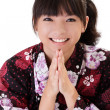 Happy Asian girl praying — Stock Photo #4090270