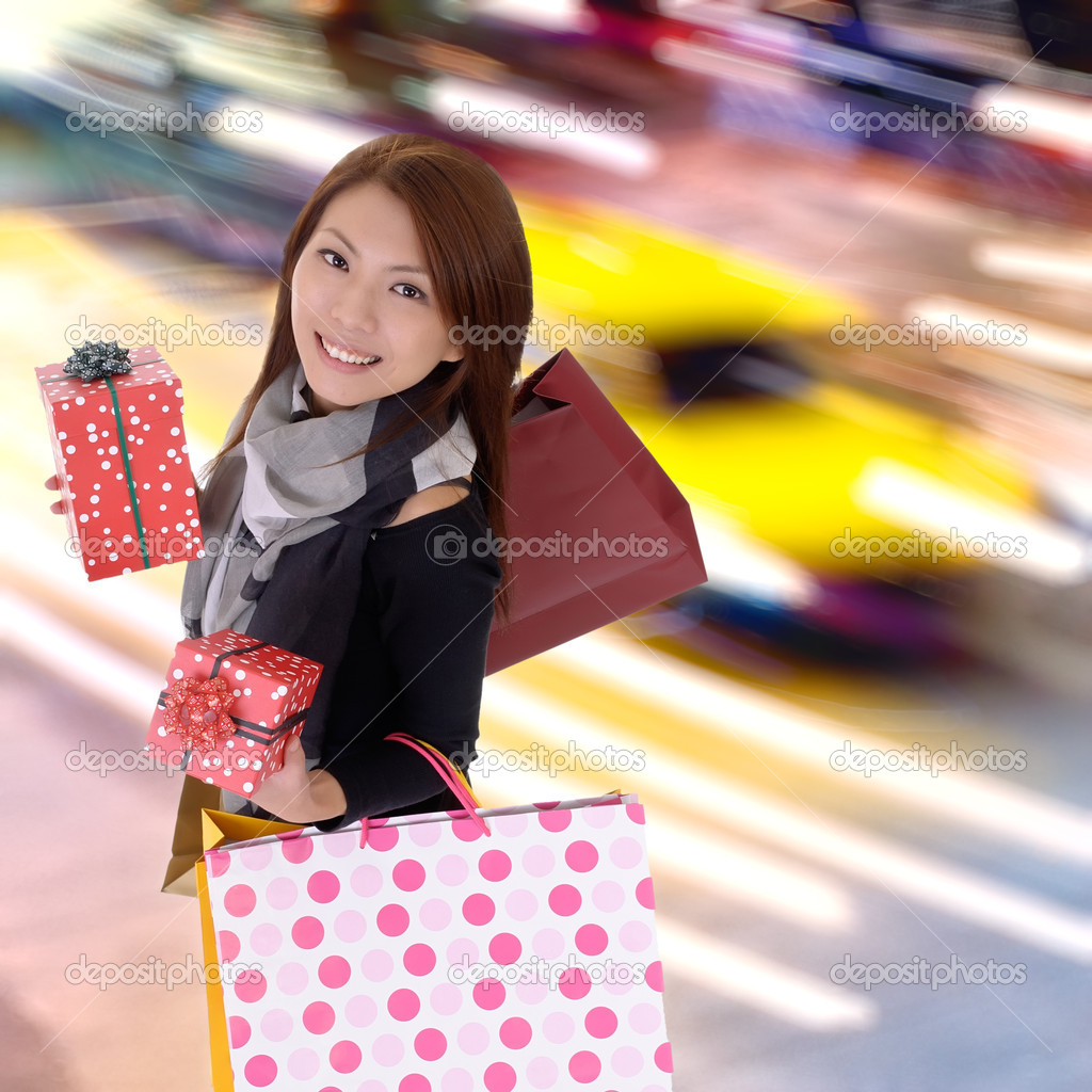 Happy shopping woman in modern colorful city night with cars motion blurred. — Stock Photo #4492205