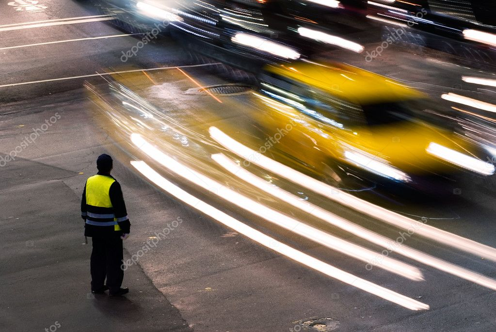 Policeman working at night in the traffic road with cars light in Taiwan, Asia.  Stock Photo #4749823