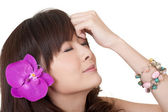 Asian woman with flower — Stock Photo