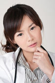 Attractive Asian female doctor — Stock Photo