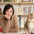 Woman with her cats — Stock Photo