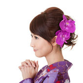 Japaneses woman praying — Stock Photo