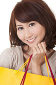 Smiling shopping woman — Stock Photo