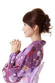 Japanese woman praying — Stock Photo