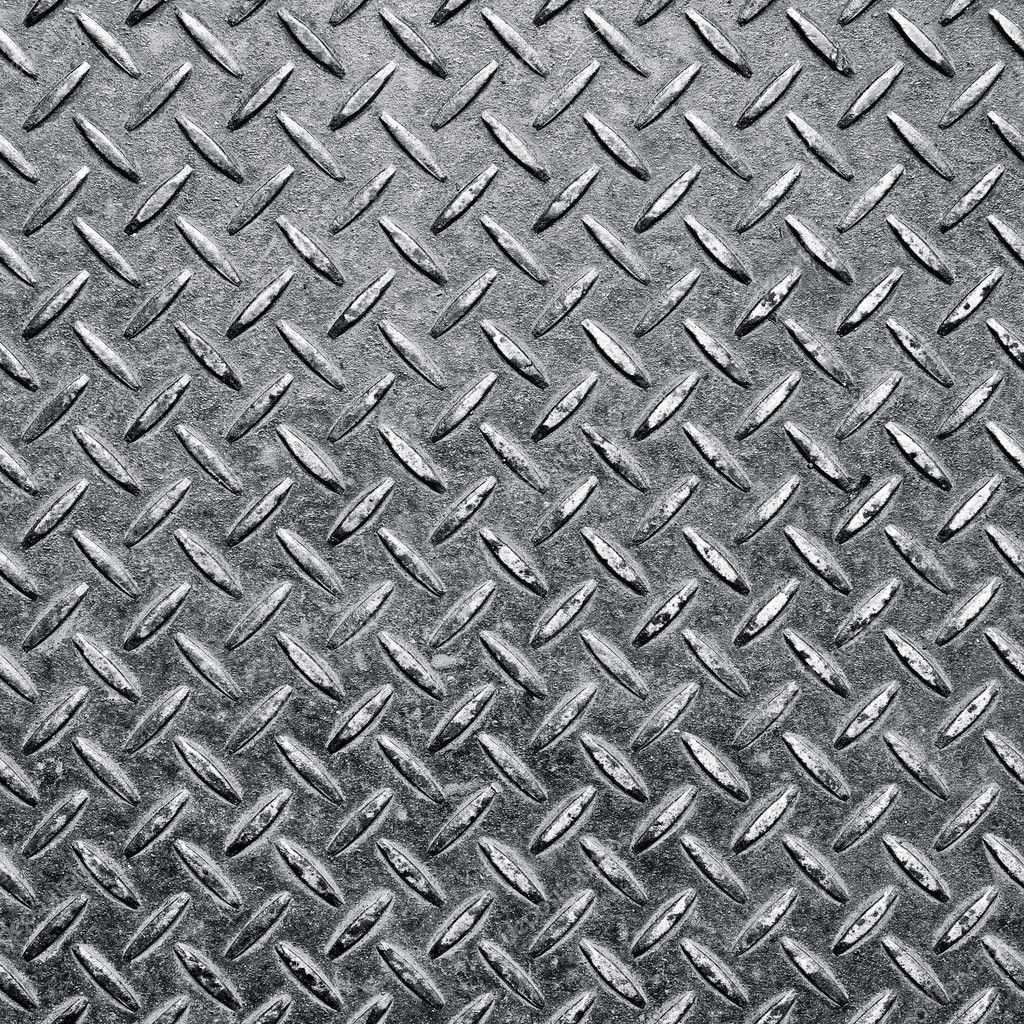 Background of metal diamond plate in silver color. — Stock Photo #5316100