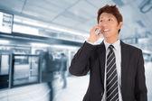 Business man using cellphone — Stock Photo