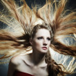 Fashion portrait of the young sexy woman with flying hair — Stock Photo #4547407