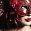 Beautiful young womin red mysterious mask — Stock Photo #5152913