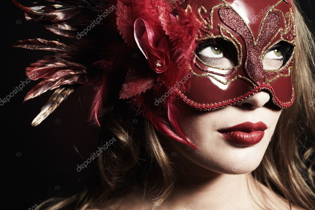 Beautiful young woman in a red mysterious venetian mask — Stock Photo #5152913