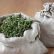 Dried herbs in linen bags — Stock Photo