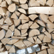 Birch logs are stacked in woodpile - Stock Photo